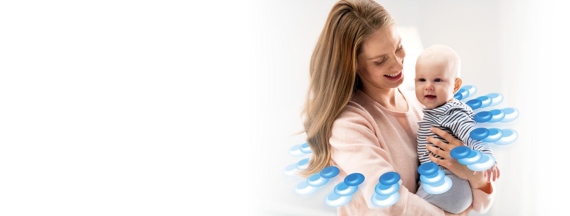 Synbiotyk Multilac: kobieta trzyma na rękach małe dziecko